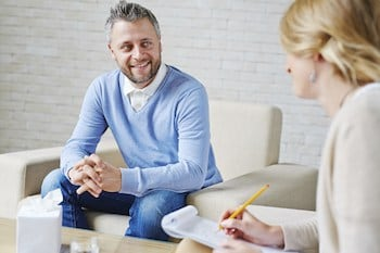Happy client talking to therapist