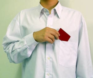 Main putting a card in his shirt pocket