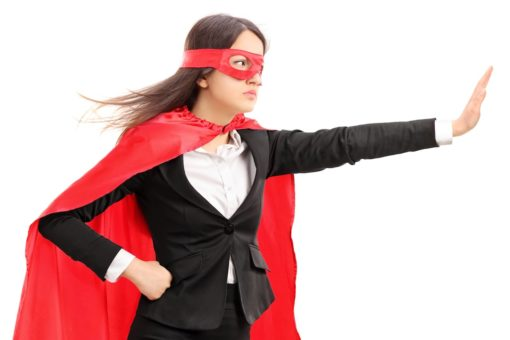 Female superhero making a stop sign with her hand