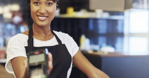 Woman With EMV Credit Card Reader
