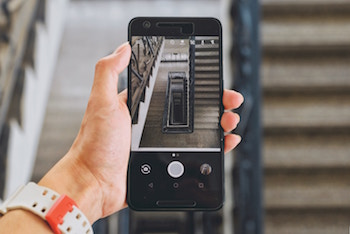Smartphone screen with a photo of a staircase going down