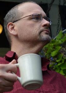 Roy with mug of coffee