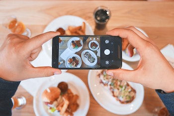 A picture of a person taking a picture of food