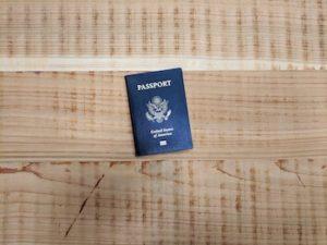 USA passport on wooden floor