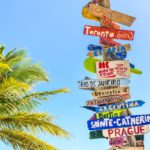 Signposts in a tropical scene