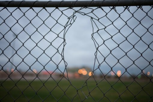 Chain link fence with a hole in it