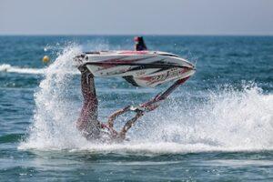 Person riding waterski upside down