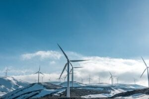Wind turbines on snowy hills